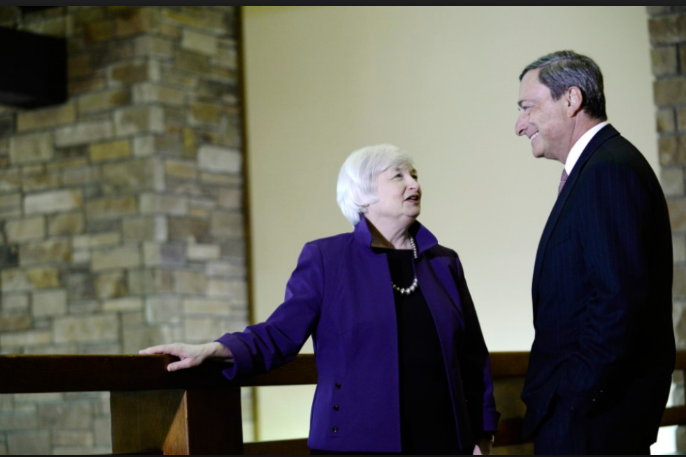 Janet Yellen, chairman of the US Federal Reserve, left, speaks with Mario Draghi, president of the European Central Bank, during the Jackson Hole economic